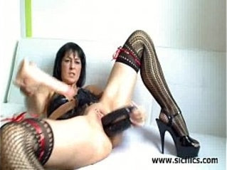Stuffing her twat with three huge dildos