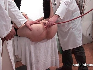 Naughty blonde ass plugged in threesome at the gyneco