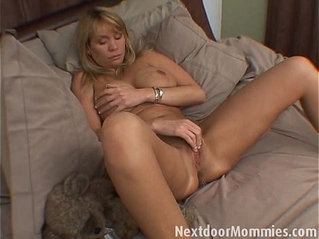 Older woman toying pussy with huge tits masturbates