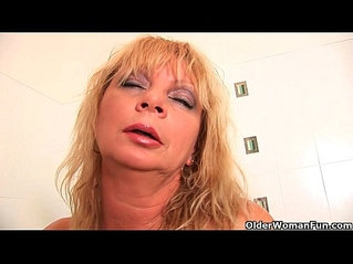 Big breasted granny gives her pussy a treat in the shower